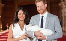 Britain's Prince Harry, Duke of Sussex, and his wife Meghan, Duchess of Sussex, pose for a photo with their newborn baby son in St George's Hall at Windsor Castle in Windsor, west of London on 8 May 2019. Picture: AFP