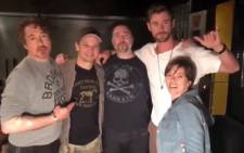 A screengrab shows 'Avengers' cast members Robert John Downey Jr,  Jeremy Renner, Chris Hemsworth and Scarlett Johansson posing with a tattoo artist (centre). Picture: instagram.com