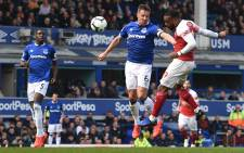 Arsenal's French striker Alexandre Lacazette heads past Everton's English defender Phil Jagielka but fails to score during the English Premier League football match between Everton and Arsenal at Goodison Park in Liverpool, north west England on 7 April 2019. Picture: AFP