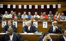 FILE: An alleged leader of the 28s gang, George Thomas and his 16 co-accused in court on 4 May 2015. Picture: Thomas Holder/EWN.
