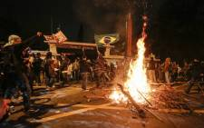 Students light a bonfire during a protest in front of the Government Palace, in Sao Paulo, Brazil on June 17, 2013. Picture: AFP.