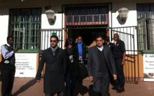 Controversial Johannesburg businessman Zunaid Moti (L) leaves the Brits Regional Court with his wife (C) on 17 July, 2012. Picture: Rahima Essop/EWN