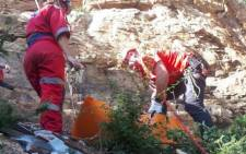 ER24 paramedics recovering the body of a woman who had fallen several metres off a mountain in Rustenburg. Picture: ER24.