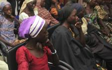 Some of the 21 freed Chibok girls are received at the Nigerian Vice President's office in Abuja on October 13, 2016. Picture: AFP
