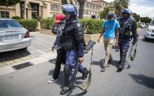 FILE: Police arrest protesting students at the Cape Peninsula University of Technology Bellville Campus. Picture: Thomas Holder/EWN