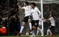 Manchester United's Dutch midfielder Daley Blind (L) celebrates scoring his goal with Manchester United's Belgian midfielder Marouane Fellaini. Picture: AFP.