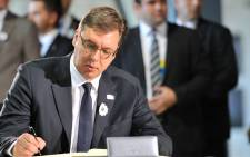 Serbian Prime Minister Aleksandar Vucic signs condolence book at Potocari memorial center prior to burial ceremony in Potocari Memorial Cemetery, on 11 July, 2015. Picture: AFP.