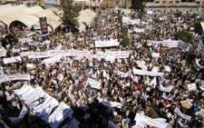 Yemeni pro-government protesters gather for a protest in Sanaa on February 3, 2011. Picture: AFP.