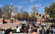 Members of the Concerned Student 1950 movement speak to the crowd of students on the campus of University of Missouri, Columbia on 9 November, 2015 in Columbia, Missouri. Picture: AFP.