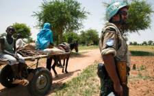 A soldier on high alert in Sudan - a country in the grip of political unrest. Picture: AFP.