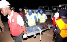 Rescue workers carry an injured victim of bomb blast on a stretcher to Plateau State Specialist Hospital, on December 11, 2014 in Jos. Picture: AFP.