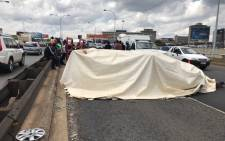 A trailer carrying over two dozen dead bodies is seen on the M1 in Braamfontein after an accident. Picture: Christa Eybers/EWN