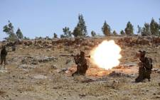 In this file photo taken on 14 August 2018 a Syrian fighter fires a rocket-propelled grenade as he attends a mock battle in anticipation of an attack by the regime on Idlib province and the surrounding countryside, during a graduation of new Hayat Tahrir al-Sham (HTS) members at a camp in the countryside of the northern Idlib province. Picture: AFP