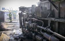 The underbelly of the truck that was torched during protests in Khayelitsha over illegal electricity connections. Picture: Thomas Holder/EWN