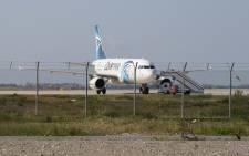 An EgyptAir Airbus A320 on the tarmac of Larnaca International Airport after it was hijacked and diverted to Cyprus on 29 March 2016. Picture: AFP.