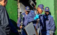 Police raid a house in Westbury, Johannesburg, on 26 June looking for drugs. Picture: Michelle Lubbe/EWN.