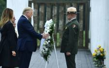 US President Donald Trump and First Lady Melania Trump lay a wreath during a ceremony commemorating the 19th anniversary of the 9/11 attacks, in Shanksville, Pennsylvania, on 11 September 2020. Picture: AFP