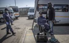 A barber shaving a customer's head gets reprimanded by the police for operating during lockdown. Picture: Abigail Javier/EWM