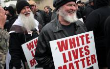 "People hold signs during a ""White Lives Matter"" rally on 28 October 2017 in Shelbyville, Tennessee. Tennessee Gov. Picture: AFP."