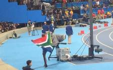 Luvo Manyonga, draped in the South African flag, after winning silver in the long jump final in Brazil. Picture: Twitter @MbalulaFikile.