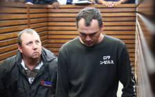 FILE: Willem Oosthuizen and Theo Jackson make their way to the dock at the Middleburg Magistrates Court during their appearance on 16 November 2016. Picture: Christa Eybers/EWN
