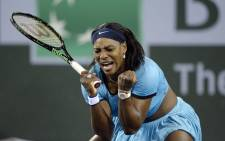 Serena Williams reacts after breaking Agnieszka Radwanska serves during the second set tie-breaker during day 12 of the BNP Paribas Open at Indian Wells Tennis Garden on 18 March 2016. Picture: AFP