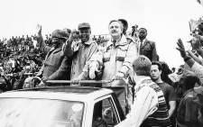 16 October 1994: Mangosuthu Buthelezi, Nelson Mandela and Pik Botha attend a rally. Picture: Gallo Images/Avusa/Johan Kuus