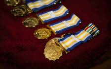 The Deputy Minister of Police, Bongani Mkongi, handed over Centenary Medals to senior managers in the Western Cape. Picture: Cindy Archillies/EWN