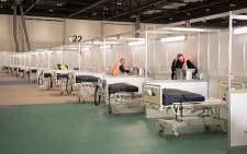FILE: The ExCel centre in London on 30 March 2020, which has been transformed into a field hospital to be known as the NHS Nightingale Hospital, to help with the COVID-19 pandemic. Picture: AFP
