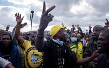 Supporters gesture as they gather in front of former South African president Jacob Zuma's rural home in Nkandla on July 4, 2021. On July 3, 2021, hundreds of supporters gathered to show solidarity for former South African president Jacob Zuma outside his Nkandla homestead, as the deadline looms for him to surrender to the authorities. Picture: Emmanuel Croset / AFP