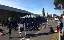 UCT students block one of the entrances to the university's main campus. Picture: Shamiela Fisher/EWN