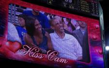 US President Barack Obama and his wife Michelle, are seen on a large screen during the Men's USA Basketball vs Brazil game at the Verizon Center in Washington, DC. Picture: AFP.