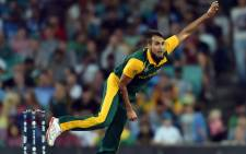 South Africa's Imran Tahir bowls during the 2015 Cricket World Cup Pool B match between South Africa and the West Indies at the Sydney Cricket Ground on 27 February, 2015. Picture: AFP.