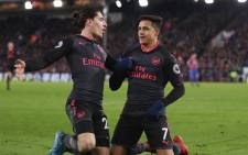 Arsenal's Hector Bellerin (left) celebrates a goal with goalscorer Alexis Sanchez. Picture: @HectorBellerin/Twitter