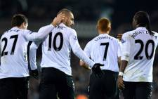 Fulham's Croatian forward Mladen Petric (2L) celebrates with teammates including Fulham's Colombian striker Hugo Rodallega (R) after scoring a goal during a English Premier League football match. Picture: AFP