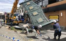 Workers remove a fallen signboard hit by typhoon Faxai in Kamakura, Kanagawa prefecture on 9 September 2019. Picture: AFP