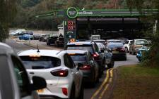 Motorists queue for petrol and diesel fuel at a petrol station off of the M3 motorway near Fleet, west of London on 26 September 2021. Picture: Adrian Dennis/AFP