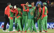 FILE: Bangladeshi players celebrate beating Afghanistan in the pool A 2015 Cricket World Cup match between Afghanistan and Bangladesh in Canberra on February 18, 2015. Picture: AFP.
