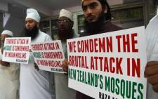Indian Muslims and clerics hold posters to condemn the mass shooting that occured at multiple mosques in New Zealand city of Christchurch, during an Islamic seminary in Mumbai on 14 March 2019. Picture: AFP