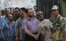 Egyptians stand in queues to cast their votes in the country's presidential elections. Picture: AFP