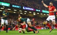 Liam Williams crossed for the home side's second try on the quarter hour, taking a lofted mispass from Anscombe and cutting back inside the covering Siya Kolisi.
