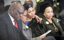 Gugu Zulu's widow Letshego (Center), and Zulu's mother (Far Right) sit together at his memorial at Kyalami race track. Picture: Thomas Holder/EWN