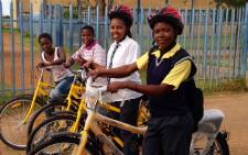 Children at Thamsanqa Secondary School in Orange Farm with their new bicycles. Picture: World Vision SA and Qhubeka.