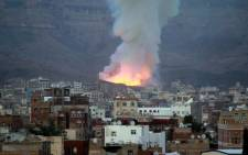 FILE: Smoke billows following an air-strike by Saudi-led coalition on May 11, 2015, in the Yemen capital of Sanaa. Picture: AFP.
