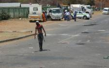 FILE: University of Limpopo student takes part in the Fess Must Fall protests. Picture: Pelane Phakgadi/EWN.