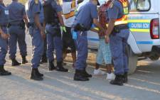 FILE: Police search a member of the public. Picture: SAPS