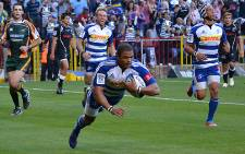 FILE: Juan de Jongh scores a try in his 50th Super Rugby game against the Sharks in Cape Town on 13 April 2013. Picture: Aletta Gardner/EWN.