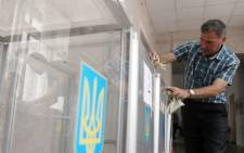 An activist group claims to have destroyed the election commission's computer system with a virus. Picture: AFP.