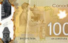 The controversial Canadian C$100 note which depicts and an Asian woman looking through a microscope. Picture: Flickr.