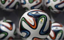 The official ball of the 2014 World Cup, 'The Brazuca' is featured in an advert by Adidas. Picture: AFP.
